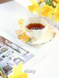 Antique Paragon flower/floral handle tea cup and saucer