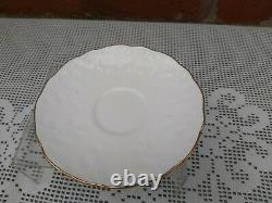 Aynsley flower handle cup and mismatch saucer