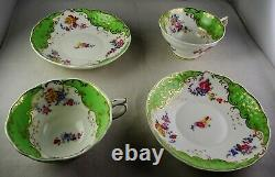 Pair Of Antique Soft Paste Tea Cup & Saucer Sets Hand Painted Flowers Green Gold