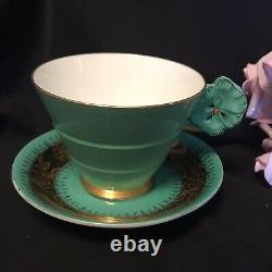 Paragon Flower Handle Tea Cup & Green Gold Unstamped Saucer